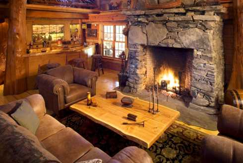 Log cabin home plans a spectacular hunter 39 s haven for Cabin fireplace pictures