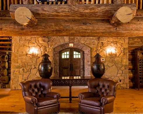 The Log Cabin Interior Design Of The Soaring Great Room Is Absolutely