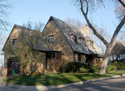 Beautiful english inspired stone cottage style home for Stone cottage home plans