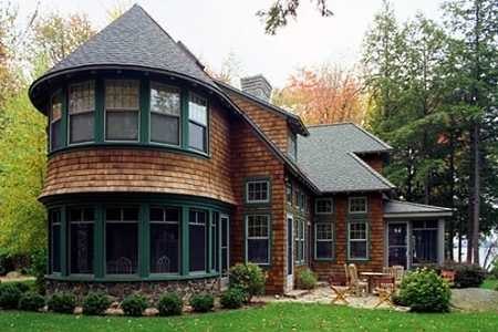 Standout cottage style homes irresistible charm for Cottage style roof design