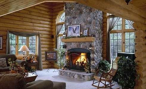 The log cabin fireplace warming hearts for centuries for Cabin fireplace pictures