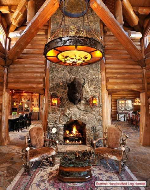 Log home decorating on a truly grand scale for Log cabin fireplace designs